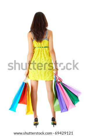 Rear view of pretty woman walking away after shopping on white background - stock photo