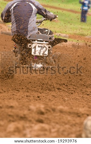 Rear view of Quad bike roost, focus on the dirt - stock photo