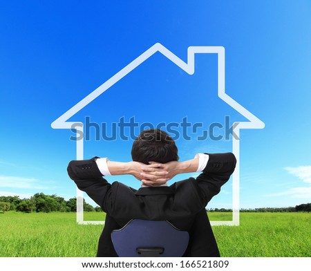 Rear view of relax business man sit on chair and dreaming a house, Real estate Concept concept - stock photo