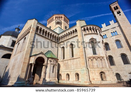 Rear view of San Vigilius cathedral of XII-XIV in main square of Trento built of pink marble of Verona in early gothic style - stock photo