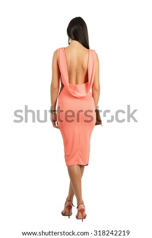 Rear view of sensual beauty in evening dress with bare naked open back walking away. Full body length portrait isolated over white studio background. - stock photo