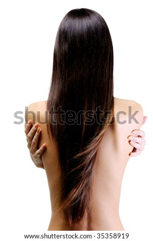 rear view of slender young woman with beautiful long straight hair - stock photo