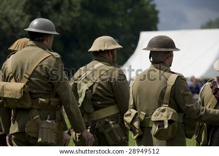 rear view of some ww1 british soldiers marching away - stock photo