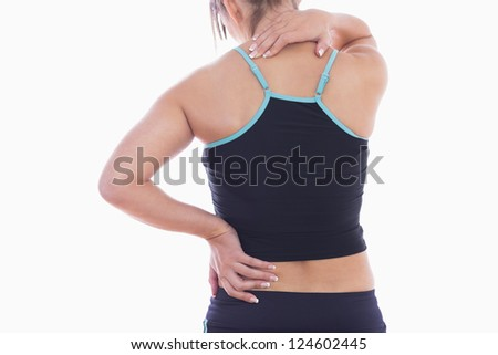 Rear view of sporty young woman massaging neck over white background - stock photo