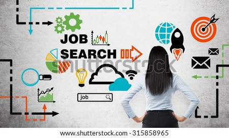Rear view of the brunette woman who is looking at the wall with colourful icons about job vacancies. A concept of recruitment process. Internship and graduate programmes. Concrete wall. - stock photo