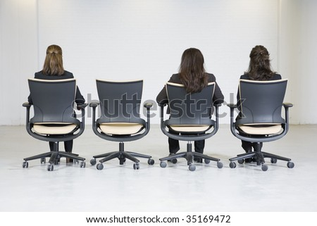 Rear view of three business women - stock photo