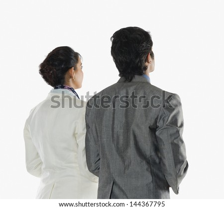 Rear view of two business executives - stock photo