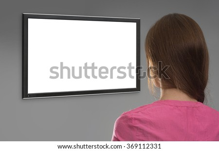 Rear View of woman looking on computer monitor with blank screen - stock photo