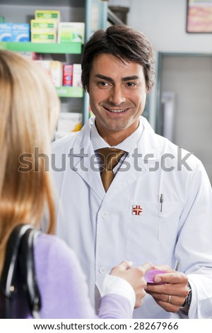 rear view of woman shopping in pharmacy. - stock photo