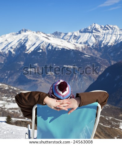 rear view of woman tanning in mountain - stock photo
