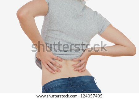 Rear view of woman with backache over white background - stock photo