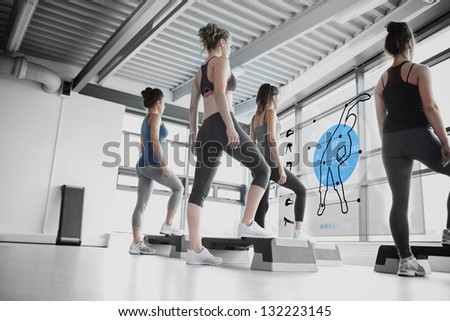 Rear view of women doing exercise with blue futuristic interface showing how to do - stock photo