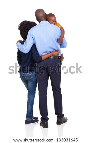 rear view of young african american couple carrying baby boy isolated on white - stock photo