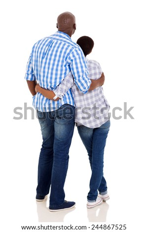 rear view of young african american couple hugging on white background - stock photo