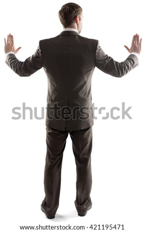 Rear view of young business man touching copy space isolated over white background - stock photo
