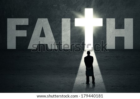 Rear view of young businessman looking at faith door