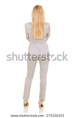 rear view of young businesswoman isolated on white background - stock photo