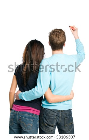 Rear view of young couple writing on blank white board. Compile with your text! - stock photo