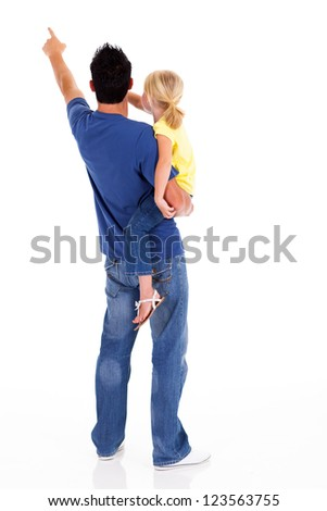 rear view of young father and daughter pointing - stock photo