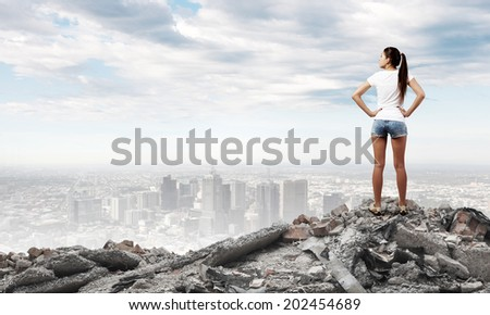 Rear view of young woman in shorts and white t-shirt - stock photo