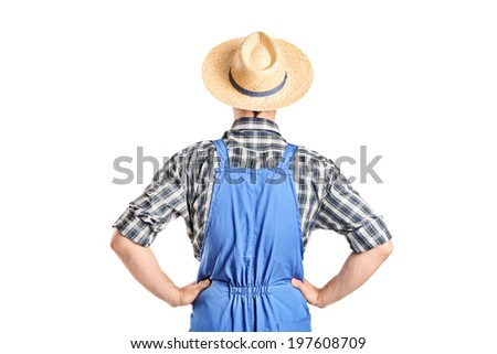 Rear view, studio shot of a male farmer in jumpsuit isolated on white background