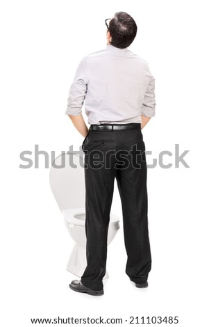 Rear view studio shot of a man taking a piss isolated on white background - stock photo
