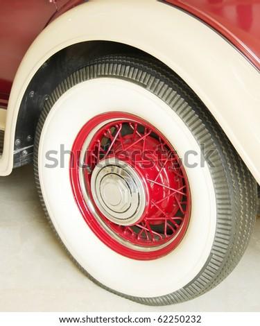Rear wheel of a antique 1932 car - stock photo