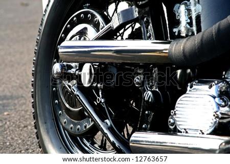 rear wheel of a classic chrome motorbike - stock photo