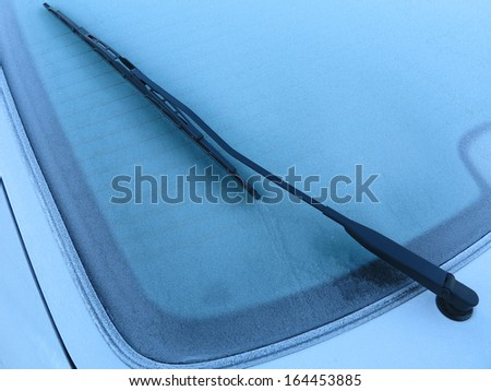 Rear window of a frozen automobile a Danish November morning. - stock photo