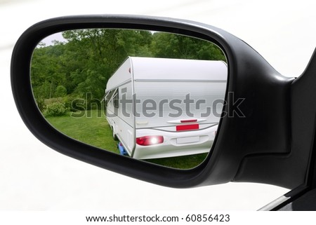 rearview car driving mirror meadow camping caravan [Photo Illustration] - stock photo