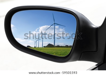 rearview car driving mirror view windmill electric aerogenerator  [Photo Illustration] - stock photo