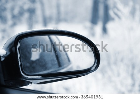 Rearview Mirror in winter. Background with a car for transportation. - stock photo