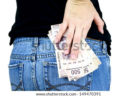 Rearview of a stack of money in the back pocket of a woman's jeans - stock photo