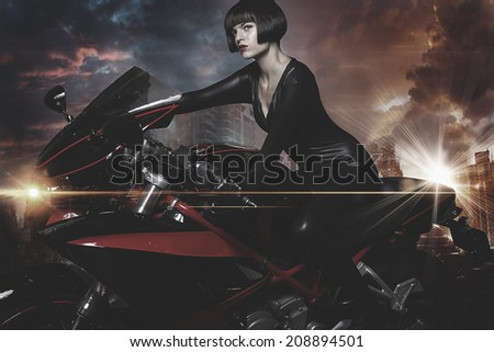 Rebel city, Sensual and Beautiful brunette woman on a motorcycle - stock photo