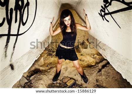 Rebel young girl posing in her hiding place - stock photo