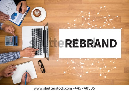 REBRAND Change Identity Branding Business team hands at work with financial reports and a laptop - stock photo