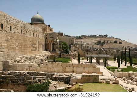 Rebuilt ruins outside the old city wall of Jerusalem, Israel with the Mount of Olives in the background.