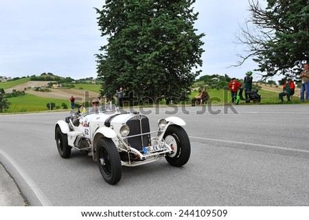 RECANATI (MC), ITALY - MAY 16: A white Mercedes SSKL 720 takes part to the 1000 Miglia classic car race on May 16, 2014 near Recanati (MC). The car was built in 1930 - stock photo