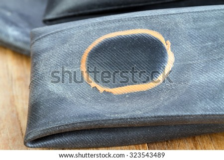 Recapped inner tube for bicycle with orange patch - stock photo