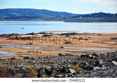Receding lake - stock photo