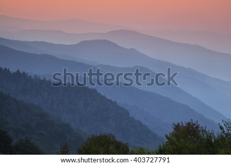 Receding mountain ridges bathed in mist at dawn at an overlook in the Great Smoky Mountains National Park - stock photo