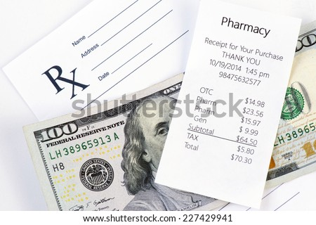 Receipt for pharmacy purchase with prescription and one hundred dollar bill. - stock photo