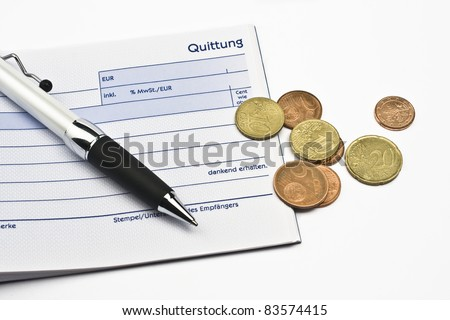 receipt with euro coins and ball-pen on white back