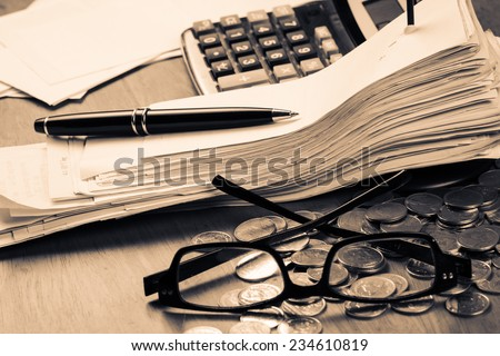 Receipts in paper nail on accountant desk - stock photo