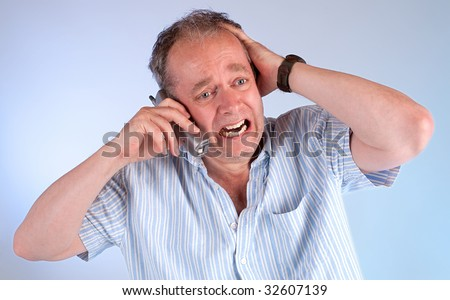 Receiving Bad News on the Phone - stock photo