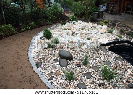 Rockery stock images royalty free images vectors for Garden pond insert