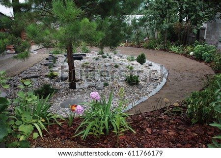 Garden rockery stock images royalty free images vectors for Garden pond insert