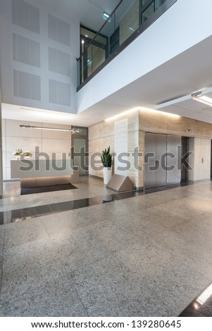 Reception and main hall in modern office building - stock photo
