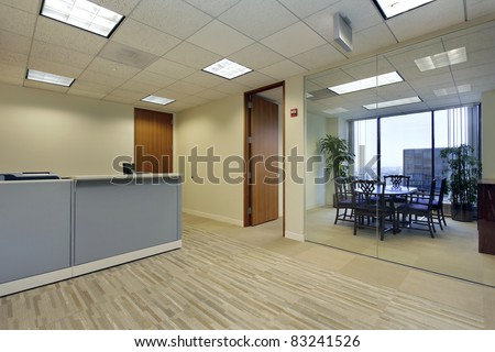 Reception area in high rise office building - stock photo