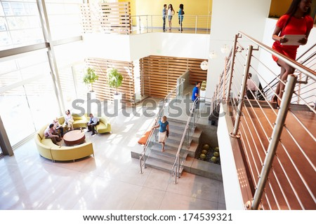 Reception Area Of Modern Office Building With People - stock photo